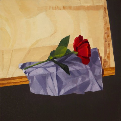 A still life painting of a red rose on a purple cloth on wooden table