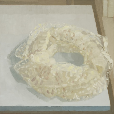 A still Life painting of a piece of lace wrapped in a circle on a table