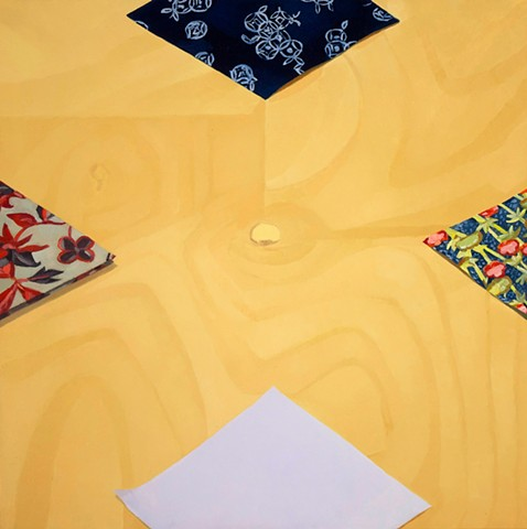 a painting of origami papers on a wooden table viewed from above