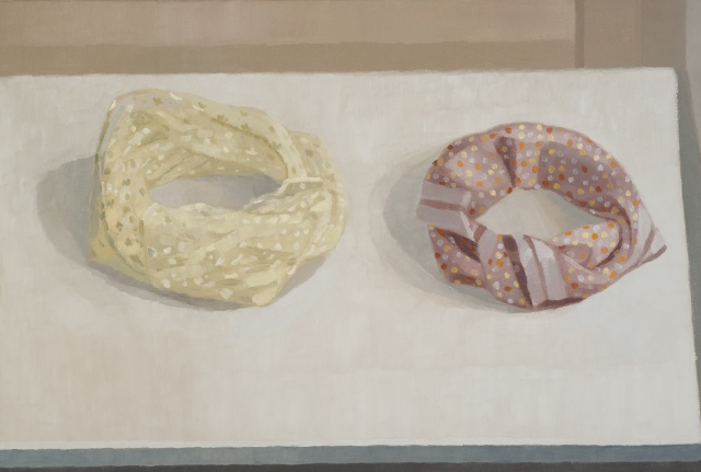 A still life painting of two scarves wrapped in circles on a table
