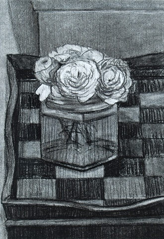White Flowers in Jar on Checkered Table