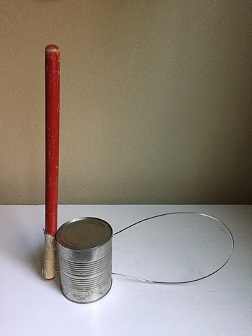 Sculpture with can, wire and stick