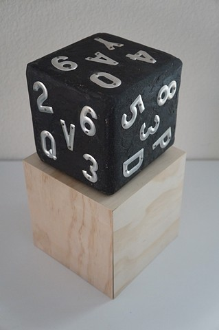 Sculptural Dice made of wood covered with black paint and aluminum letters and numbers. Made by Steve Briscoe