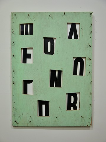 Wood wall sculpture with windows, letters