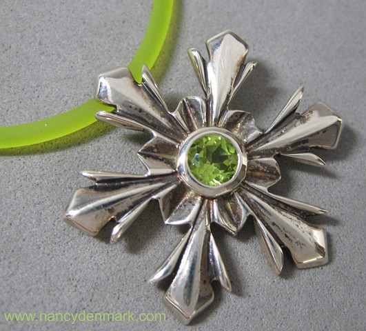 sterling silver snowflake pendant with peridot © Nancy Denmark