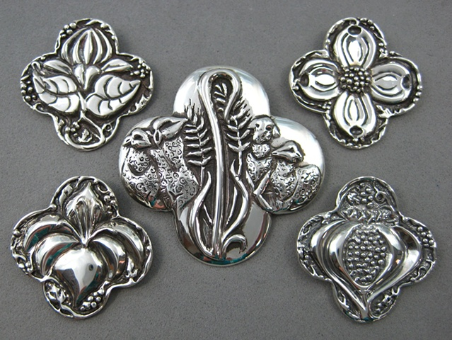 sterling silver quatrefoil shape pendants with symbolic elements ©Nancy Denmark