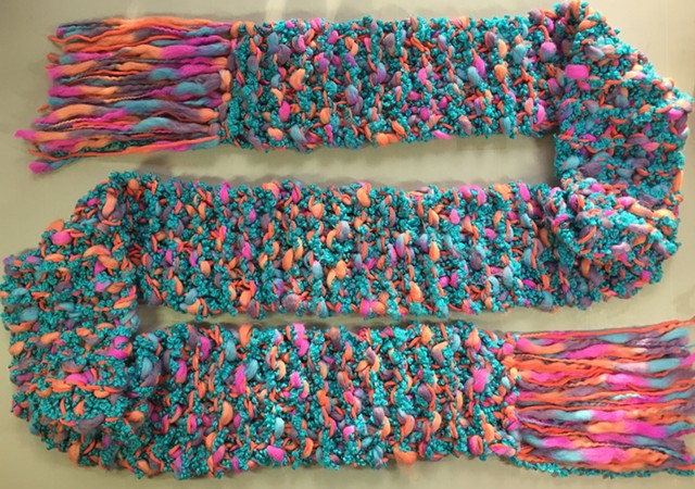 knitted scarf by Nancy Denmark in turquoise, coral, and pink