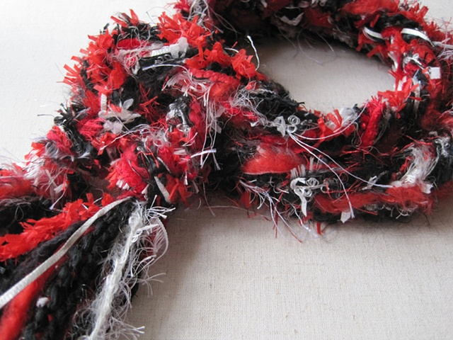 red, black, white braided yarn boa