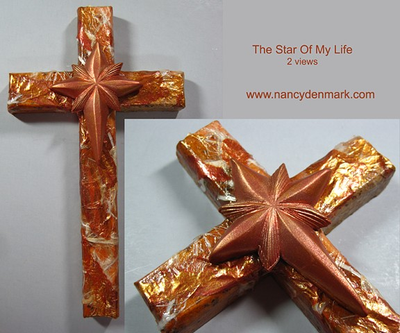 Star symbol on wood collage cross by Nancy Denmark and Patti Reed