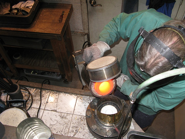 MOLTEN METAL POURED INTO THE FLASK