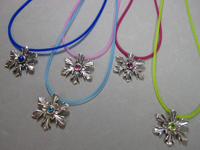 snowflake pendants by Nancy Denmark
