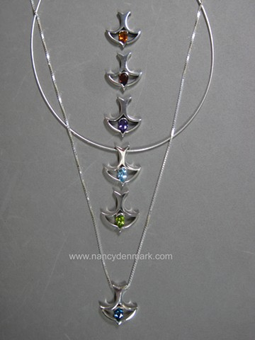 descending dove design with gemstone by Nancy Denmark