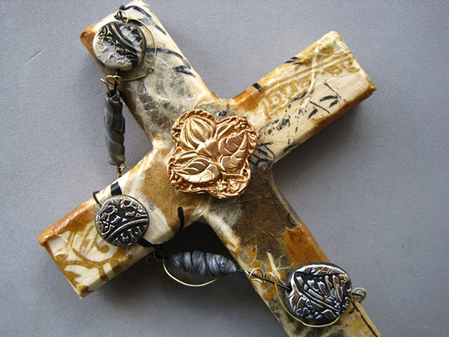 collage wall cross by Patti Reed embellished with Nancy Denmark polymer clay symbols