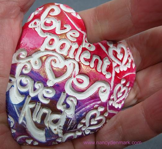 love is patient hand heart by Nancy Denmark