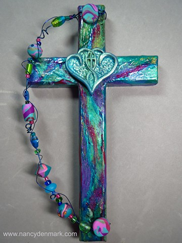 One In The Spirit symbol on collage cross made by Nancy Denmark