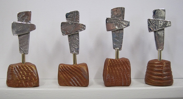 small sterling replica crosses on polymer clay stands