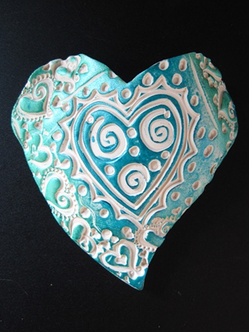 polymer clay hand held heart made by Nancy Denmark
