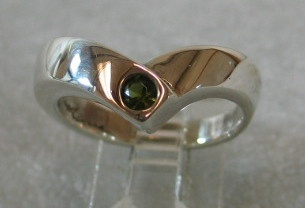 Green Tourmaline gemstone set in sterling ring designed by Nancy Denmark
