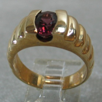 OVAL RHODOLITE GARNET IN 14K RING