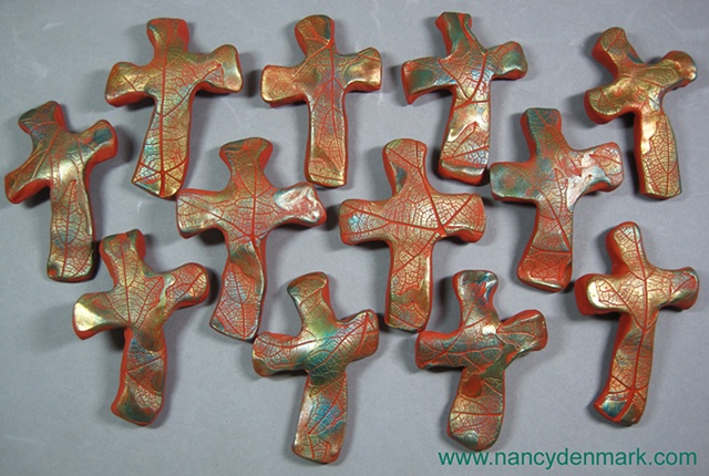 custom order of hand crosses made by Nancy Denmark of polymer clay