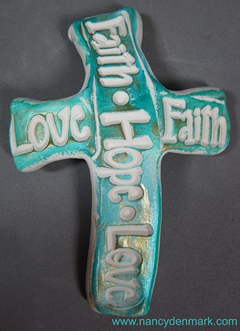 polymer clay hand cross impressed with Faith Hope Love made by Nancy Denmark