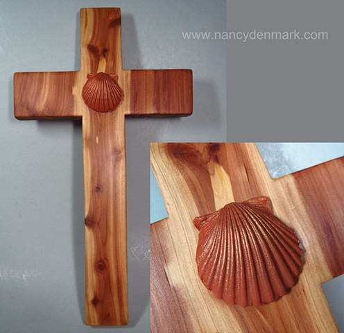 cedar cross made by Margaret Bailey with shell symbol by Nancy Denmark