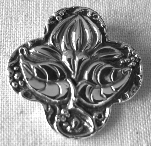 sterling silver quatrefoil pendant with lotus design by Nancy Denmark