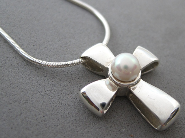 sterling silver ribbon cross with pearl by Nancy Denmark