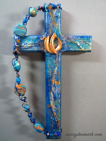 descending dove symbolism on collage wall cross by Nancy Denmark