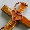 ONE IN THE SPIRIT  ON ORANGE COLLAGE CROSS CLOSE UP VIEW