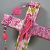 PINK RIBBON FISH ON COLLAGE CROSS CLOSE UP VIEW