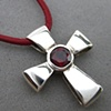 H23 GIFT OF GOD CROSS W/ FACETED GARNET