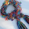 KNITTED SCARVES & BRAIDED YARN BOAS