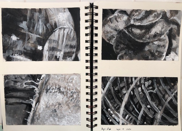 four black and white painting studies in a sketchbook