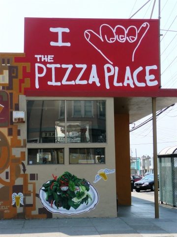 Store front signage for The Pizza Place