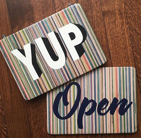 """YUP"" / ""Open"" hand painted signs on recycled skateboards by Iris Skateboards"