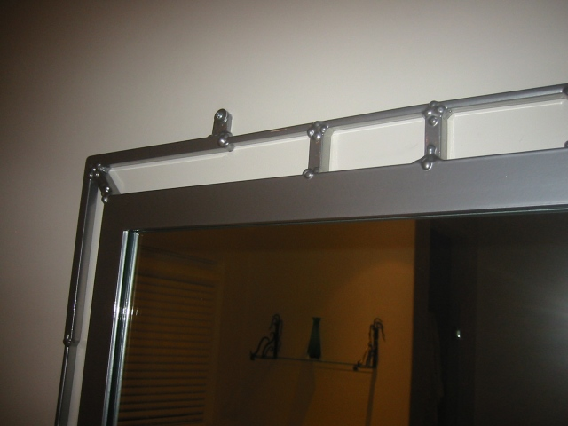 contemporary mirror detail with chrome finish