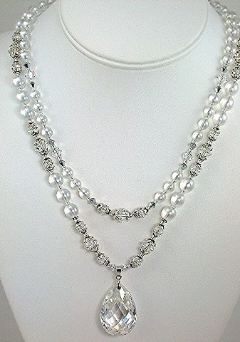 Clear Cubic Zirconia on Transluscent Pearls and Swarovski Crystal.