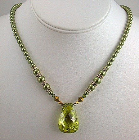 Peridot Cubic Zirconia and Swarovski Pearls.