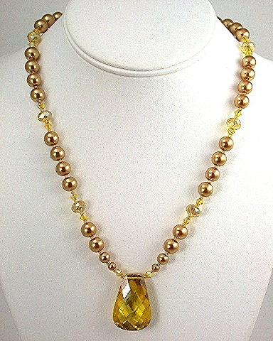 Golden Cubic Zirconia with gold pearls and Swarovski Crystal