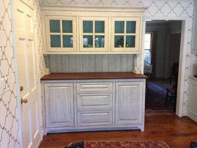 After shot of newly made custom hutch faux painted to resemble cypress
