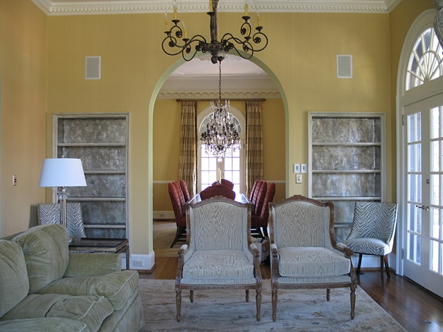 Silver-leafed bookcases