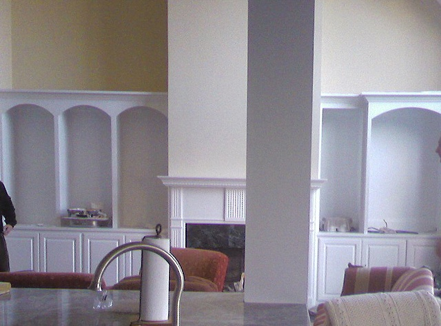 Before photograph showing mantle and kitchen pier to be painted