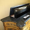 Custom wooden top painted in faux black marble and hinged to allow a modern tv to be accessed