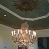 Painted gold ceiling with distressed gold leaf plaster medallion