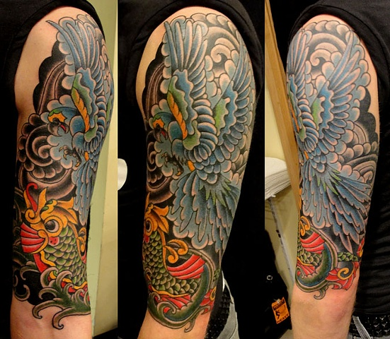 parrot and dolphin half-sleeve