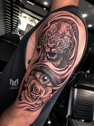 Custom Lion and Rose Tattoo