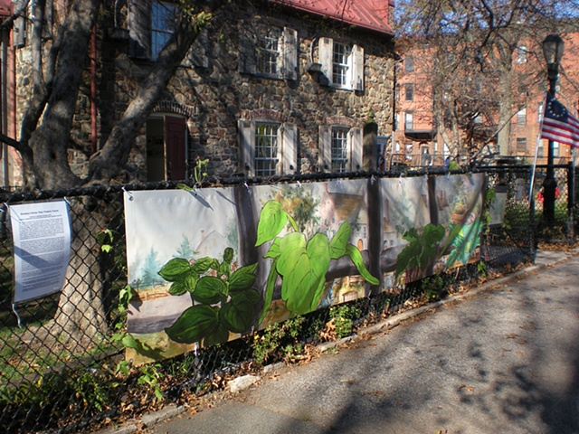 Digitally-printed banners installed on the front fence of the Old Stone House