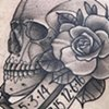 Skull and banner tattoo