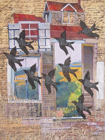 Blackbirds fly past a derelict building